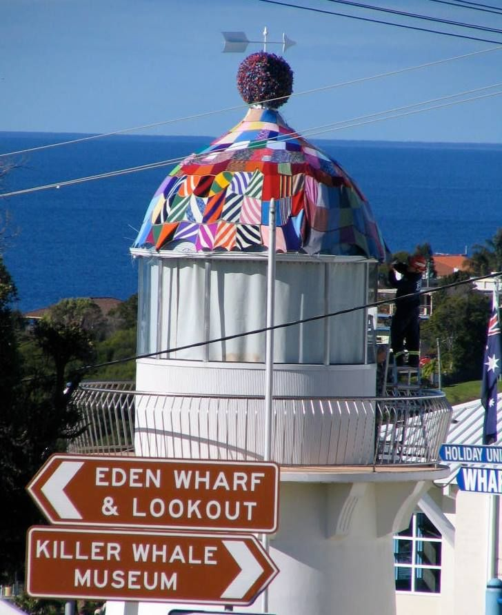 Giant beanie on a lighthouse to raise money for a cancer center's wig program. (Beanie will be disassembled and remade into blankets.)