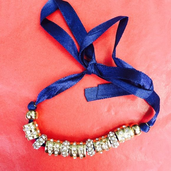 Navy Satin wrap bracelet This beautiful jewel beaded wrap bracelet on a navy satin tie has never been worn and still in the package it can in when it was ordered from Neiman Marcus. It was only taken out to take pics! Neiman Marcus Jewelry Bracelets