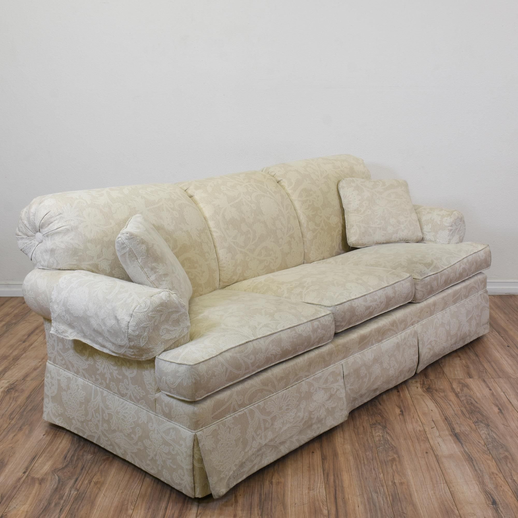 This sofa is upholstered in an orange floral pattern This