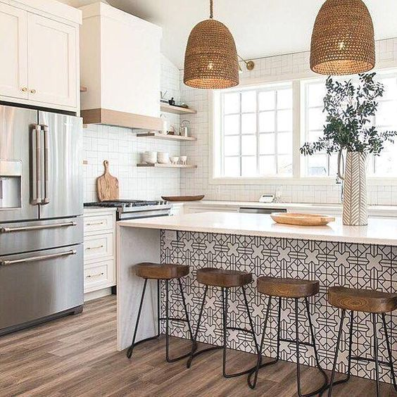 Bright All White Kitchen with Wooden Carved Kitchen stools for a white counter, and rattan lights