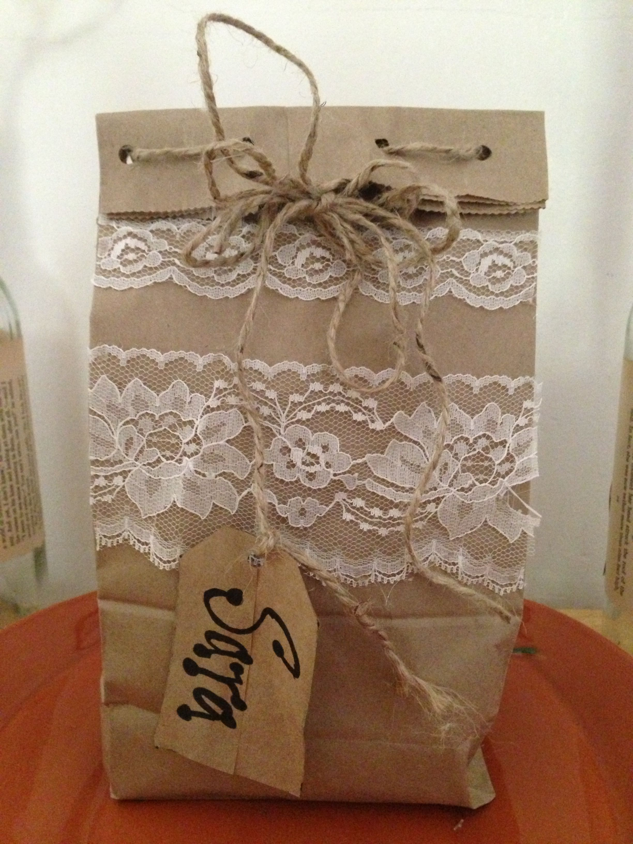 Homemade gift bag using:  brown lunch bag, left over bits of lace (found a whole bag at a yard sake for $2!!), jute twine, scissors and hot glue.