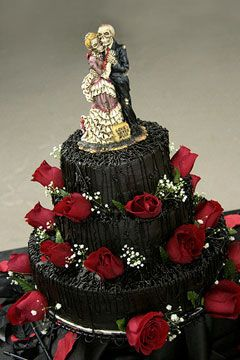 Three tier black halloween wedding cake, decorated with rich red ...