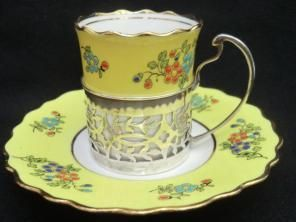 Aynsley Espresso coffee can in silver holder with saucer