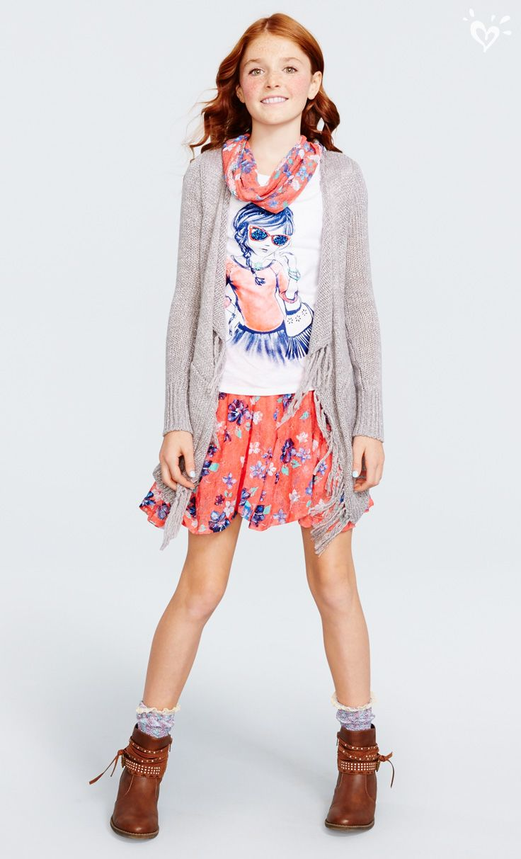 Our printed lace skirt (with built-in shorts) pairs ...