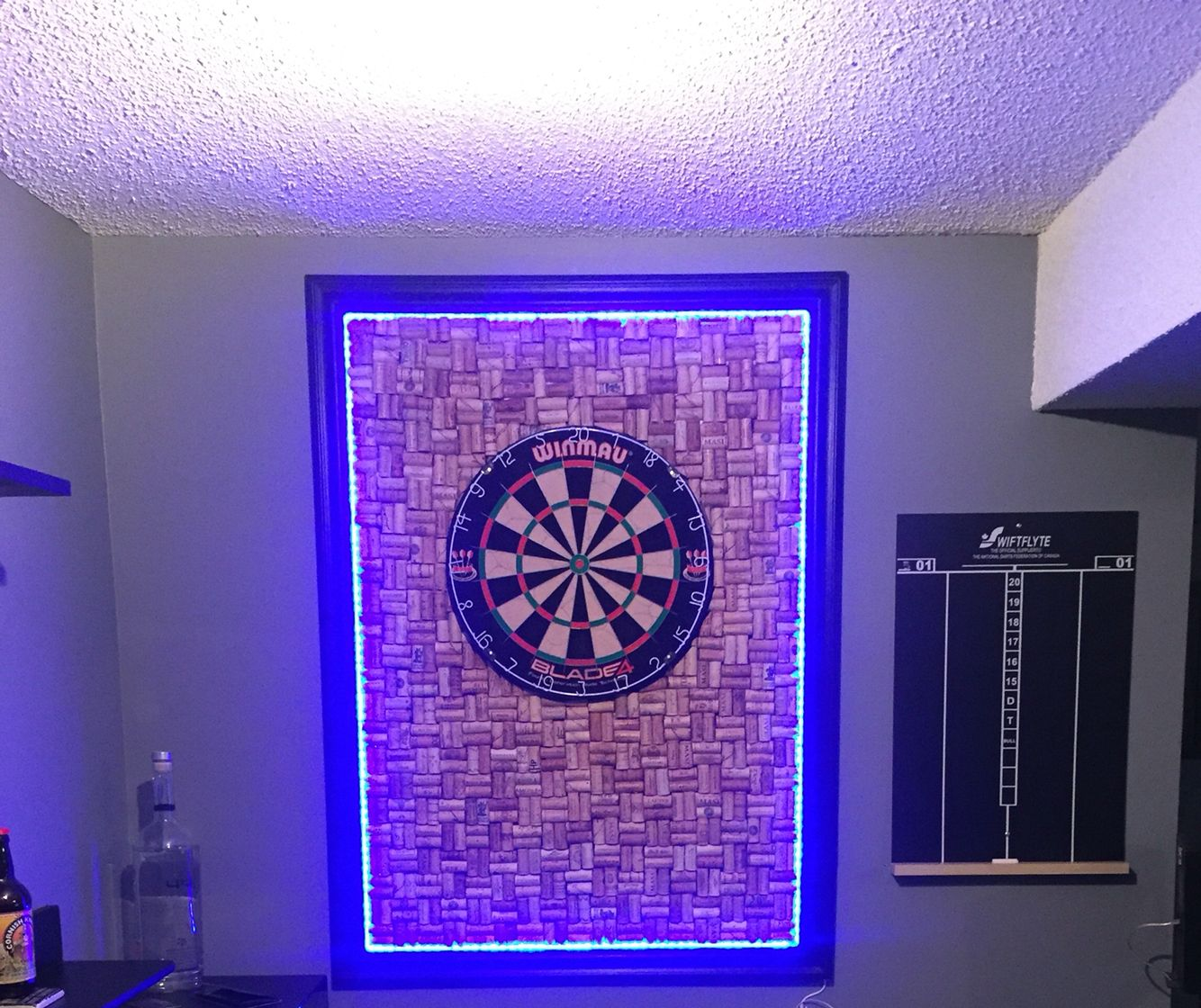 The hubby finally finished his latest ManCave project. It turned out amazing!! Dartboard with cork backing and LED lights that change colour.