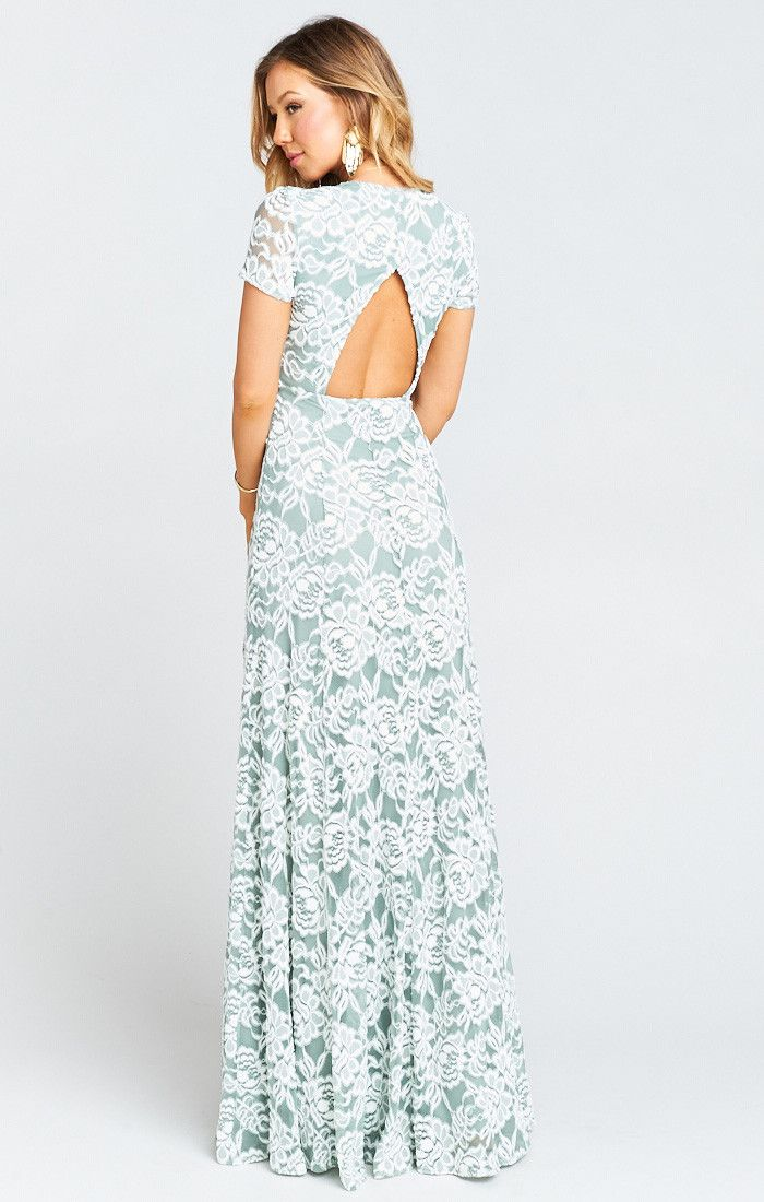 a9306503e0b No one will be able to ignore you in the Elenor Maxi. Form fitting and  elegant with a cut out in the back