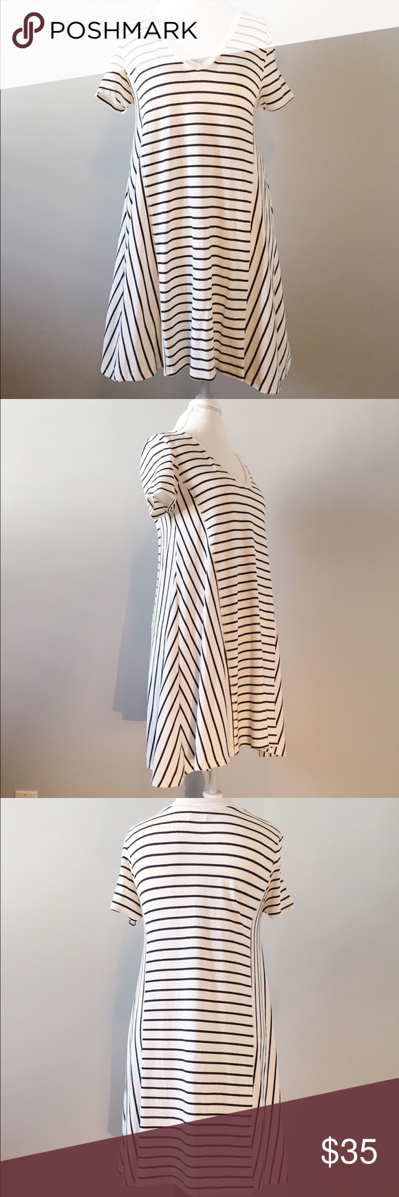 "Zara Striped T-shirt Dress This casual, float dress is perfect for a day of shopping or lunch with friends! It measures 33"" long from shoulder to hem! The stripes are a very dark almost black navy blue color. Zara Dresses Mini"