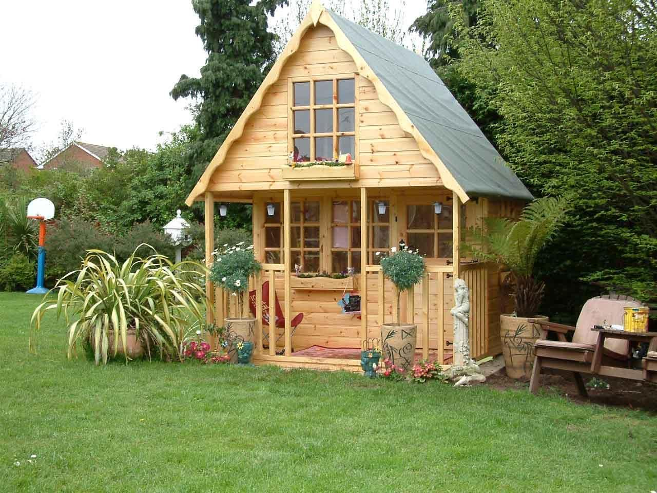 Outdoor playhouse for kids wood small playhouse designs for Wooden wendy house ideas