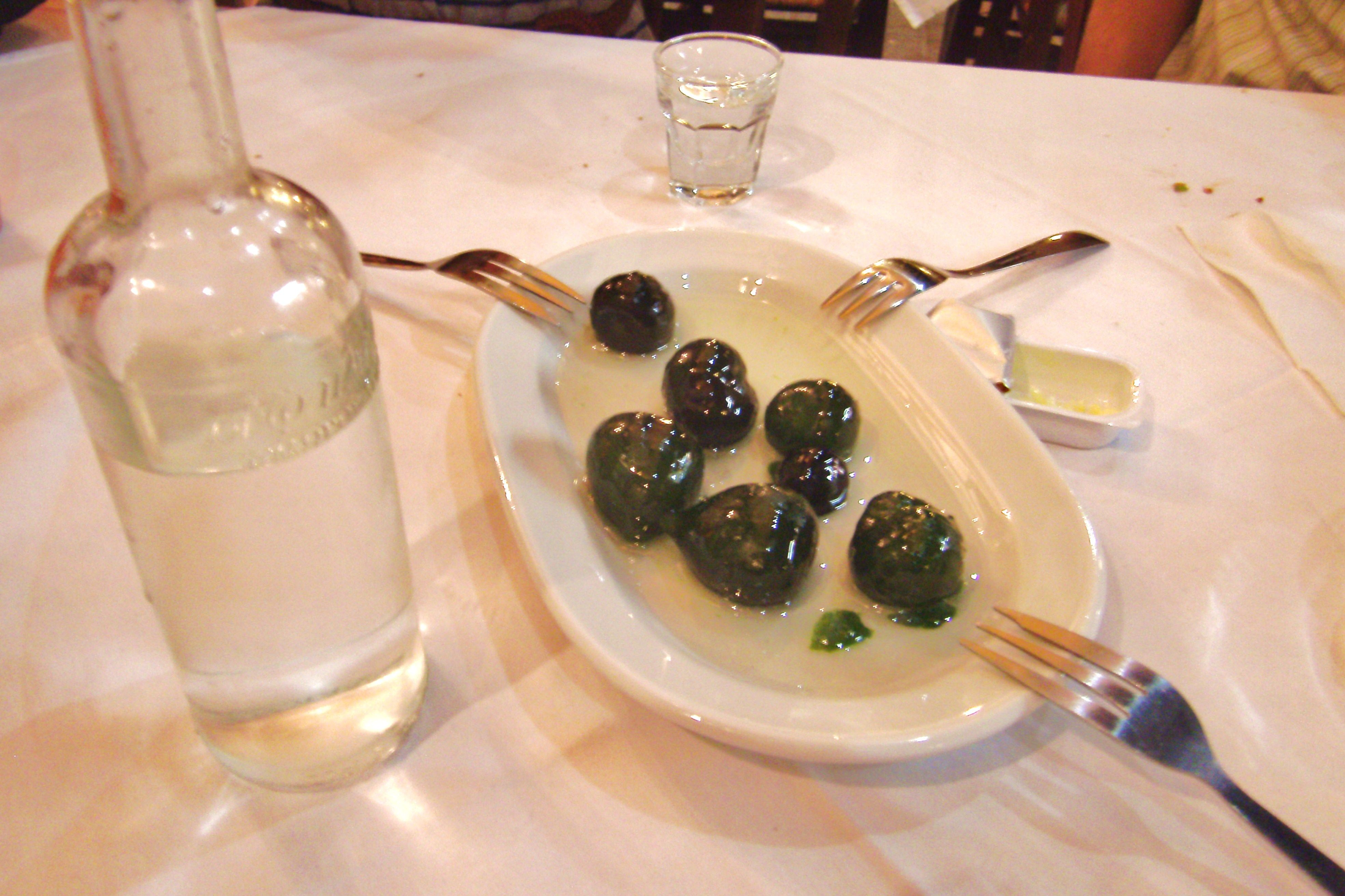This has to be the most memorable dessert I have ever had~ Candied green figs in a light syrup served with a bottle of Greek version of grappa........Kos, Greece 2011