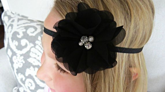 This cute handcrafted baby headband features a 3 chiffon flower in black on a 1/4 black elastic. Perfect for photo props, special occasions,