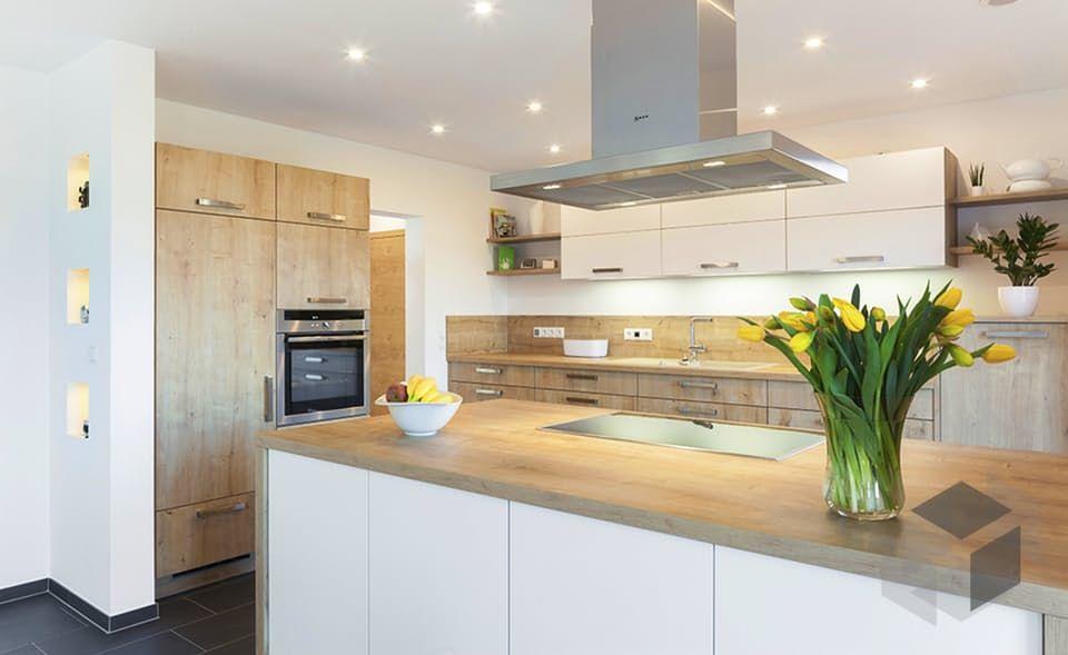 Eine offene Küche im Altholzstil Die Kücheninsel mit angehängter - theke für wohnzimmer
