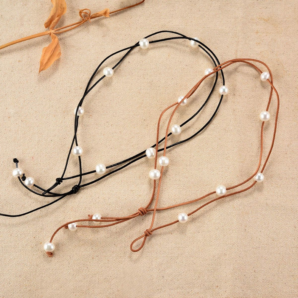 White Rice Cultured Pearl Leather 2 Strand Lariat Necklace 17 inch is part of Leather pearl necklace, Leather pearl jewelry, Pearl leather, Cultured pearls, Pearl jewelry, Lariat necklace - Twelve 910mm white cultured freshwater pearls on two strands of leather with pearl closure  The pearls can be moved on the leather  This versatile piece can be worn three different ways  It can also be worn in three different lengths as a choker (about 17