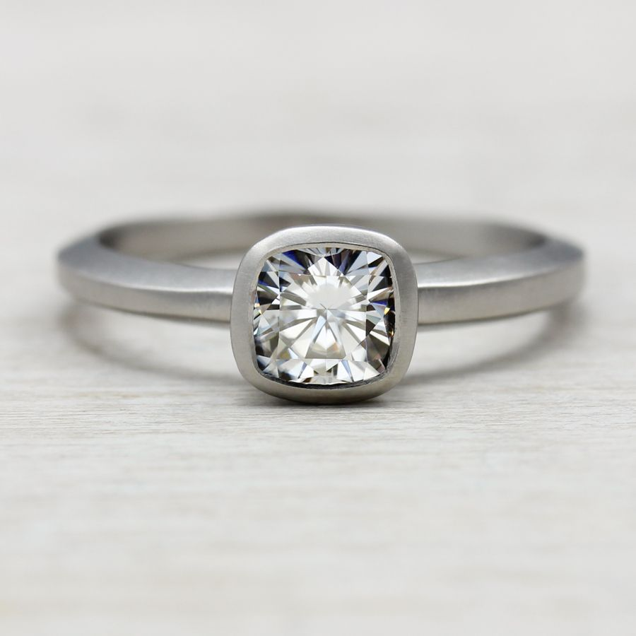 Our 5mm Cushion Cut Engagement Ring, pictured in eco-friendly recycled palladium with a Forever Brilliant Moissanite. So striking!