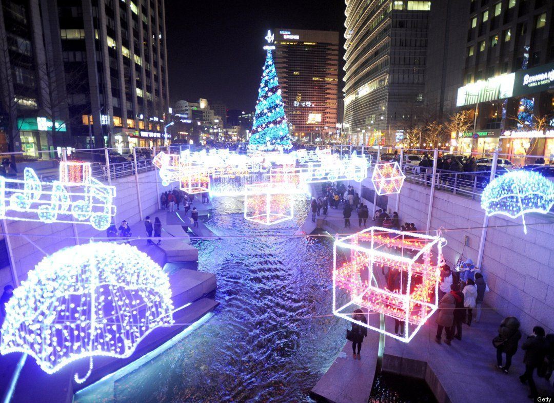 A Christmas tree and Christmas decorations are installed along the Cheonggyecheon stream in Seoul on December 25, 2010. Christmas is one of the biggest holidays celebrated in South Korea with Christians forming over half the population. AFP PHOTO / PARK JI-HWAN (Photo credit should read PARK JI-HWAN/AFP/Getty Images)