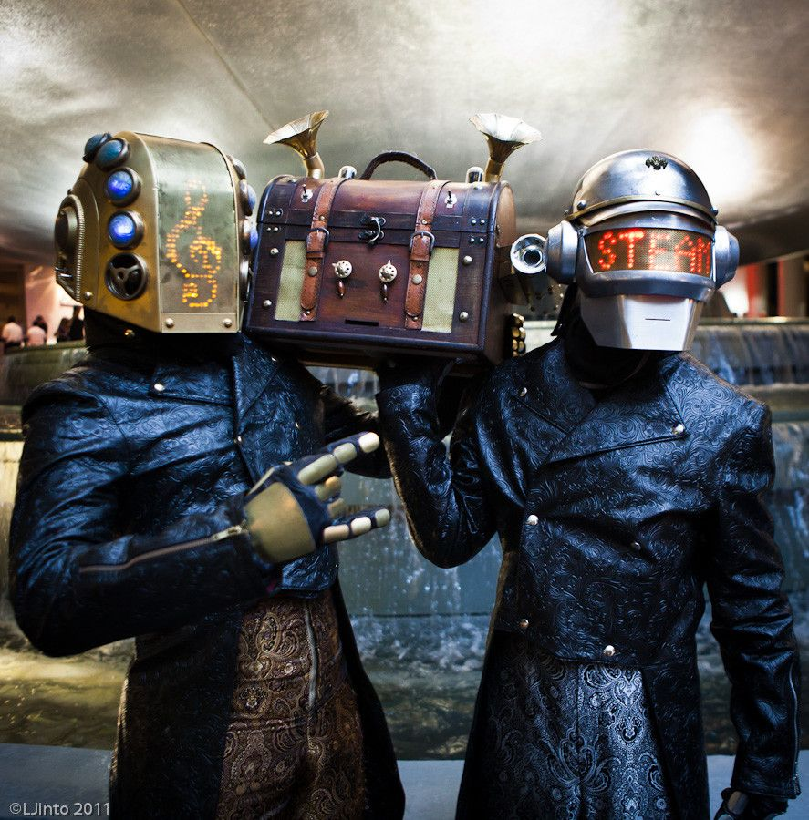 Daft Punk, Steampunk style. Awesome trench coat by the way.