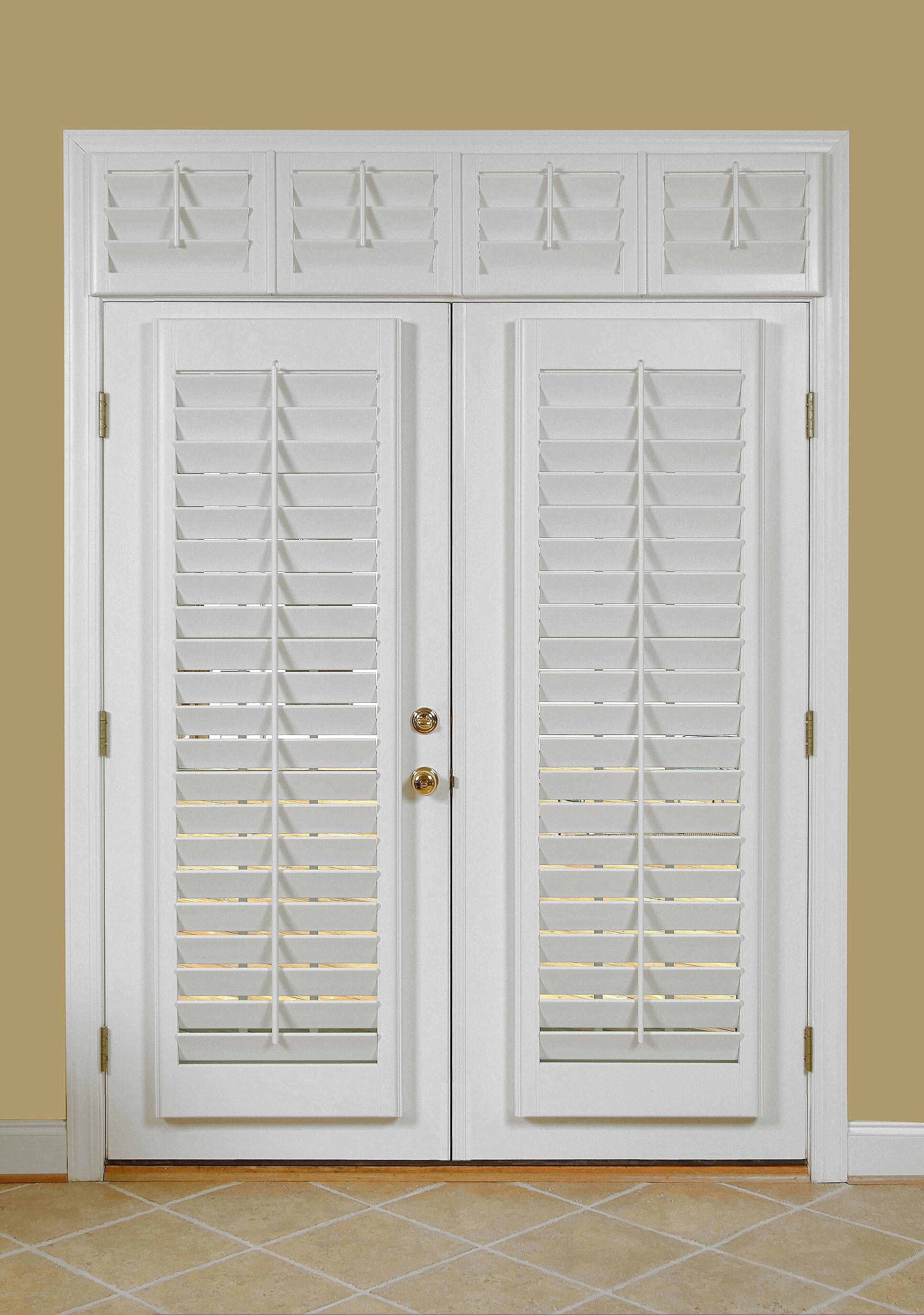 Classic, clean white shadowbox shutters on French doors