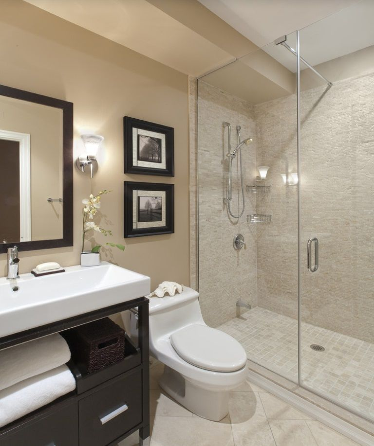 A gorgeous bathroom draped in natural hues and warm lighting Click