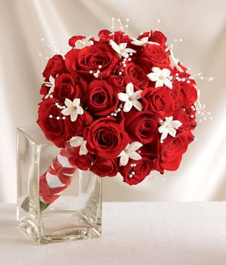 A Striking Bouquet Sixteen Red Roses Are Sprinkled With 12 White Star Like Stephanotis