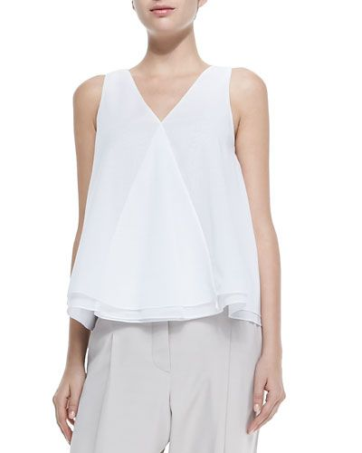 Sleeveless Layered-Hem V-Neck Top:  •Cotton voile top by Brunello Cucinelli. •V neckline. •Sleeveless. •Boxy silhouette; layered hem. •Pullover style. •Shirttail hem. •Cotton.