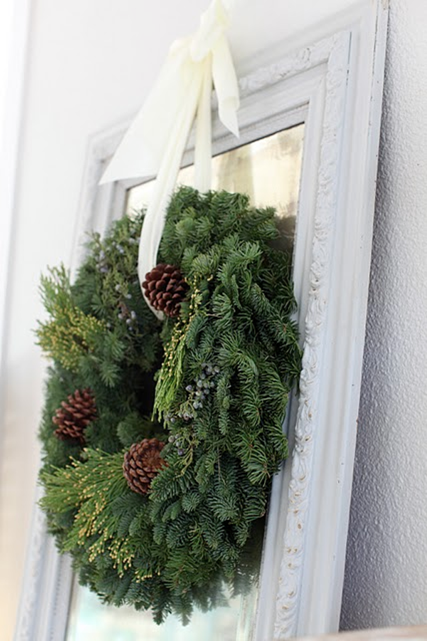 Holiday Home Decor and Decoration Ideas. Hang a wreath over a mirror.