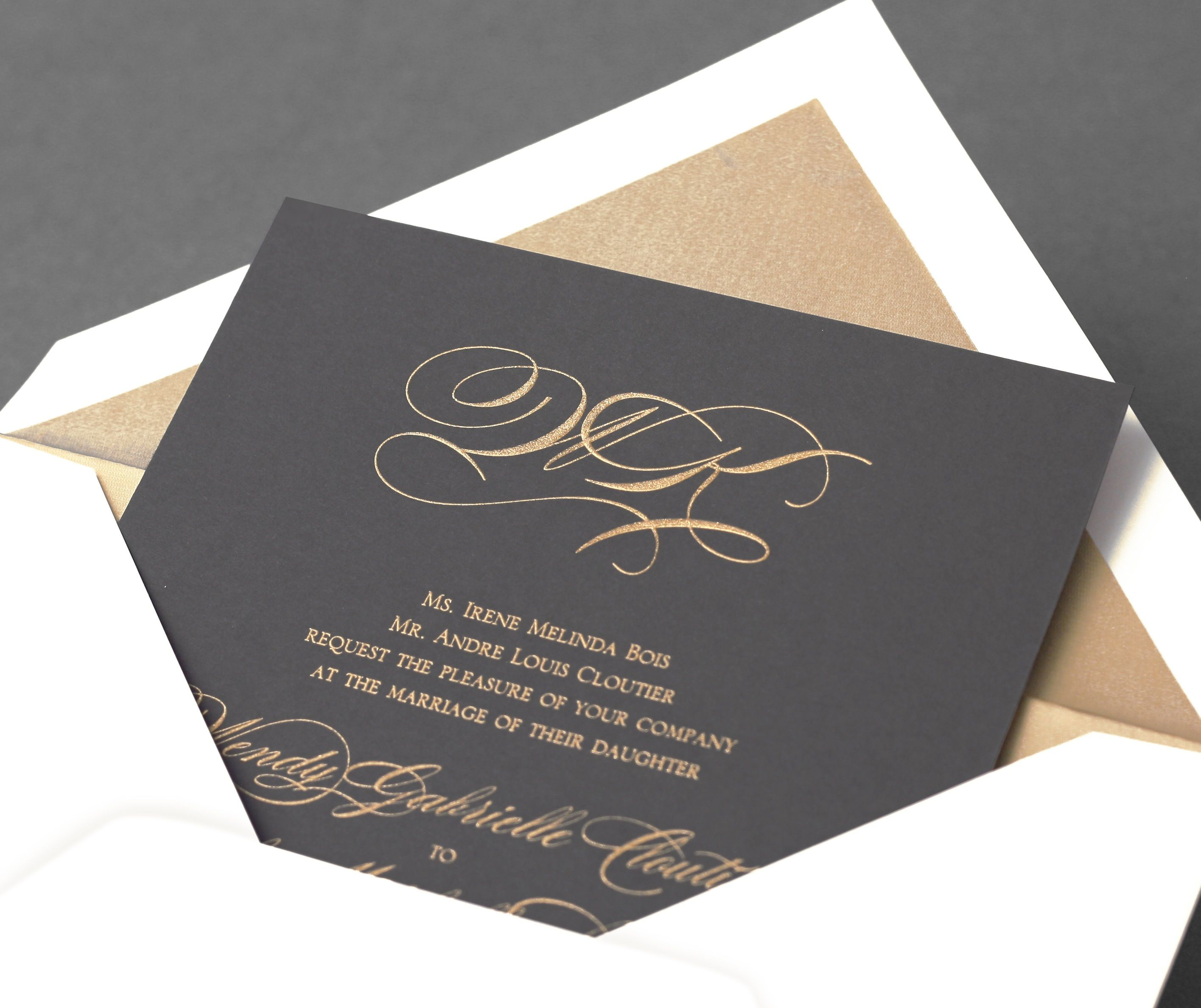 Vera Wang Pewter Wedding Invitation With A Gold Monogram.Available At  Honey Paper.