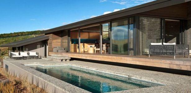 Maison bois et pierres avec une jolie petite piscine en Nouvelle