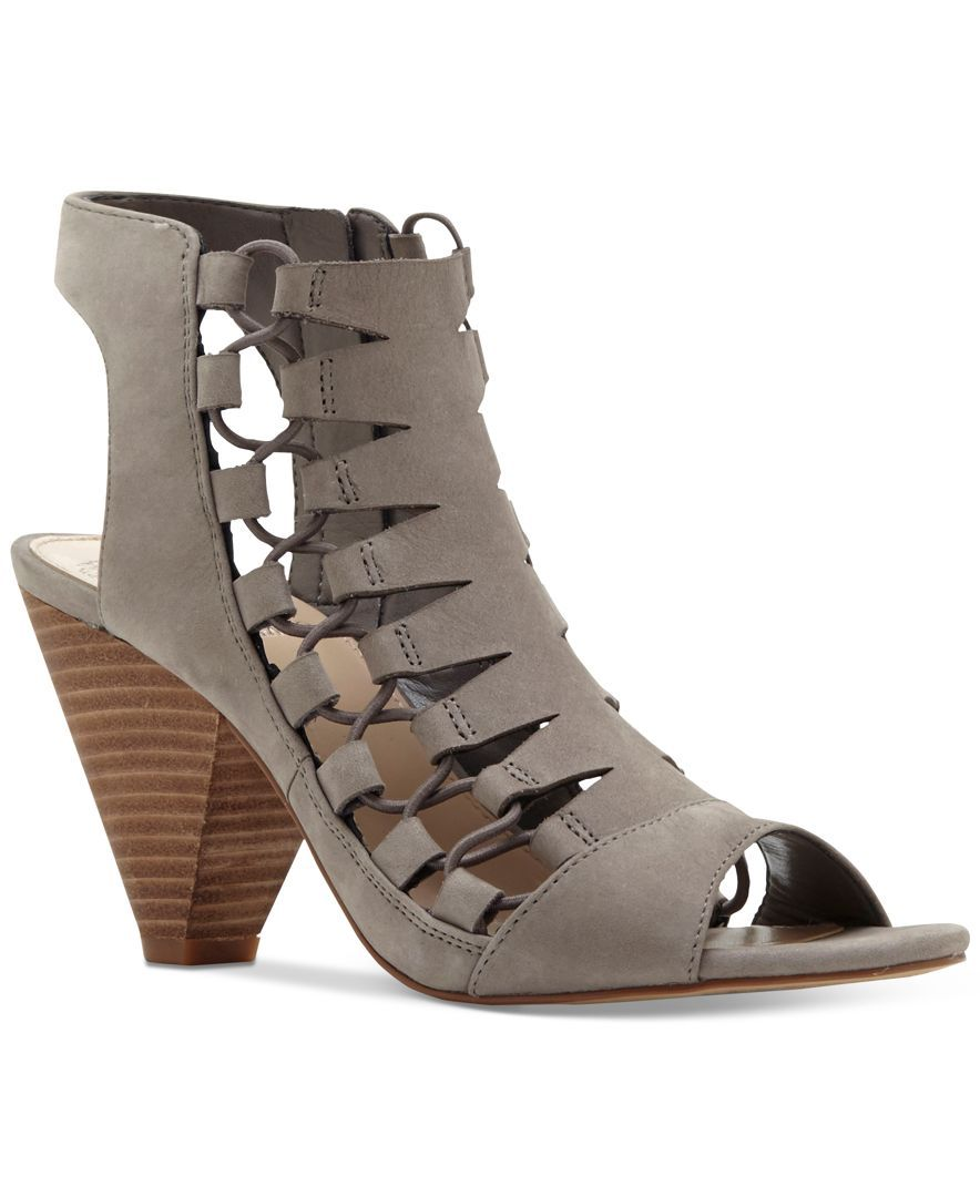 2e846254cd8 Vince Camuto s Eliaz sandals create a unique gladiator look with ghillie  lace-up details at the sides and a strappy design.