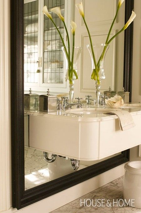 love the cantilevered sink and mirror and also the finishing detail on the corner