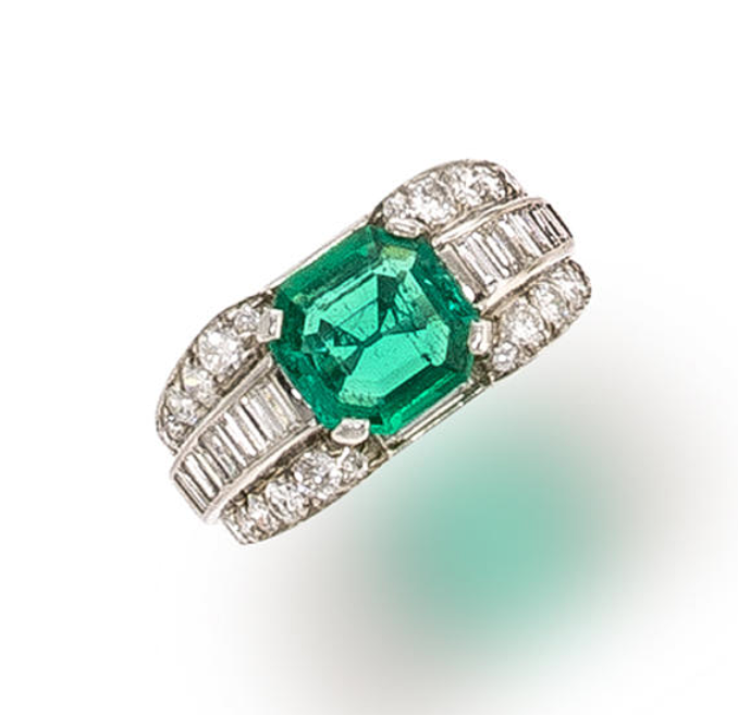 An emerald and diamond ring centering a cut-cornered square-cut emerald within rounded shoulders of baguette and round brilliant-cut diamonds; emerald weighing approximately: 1.60 carats; estimated total diamond weight: 1.90 carats; mounted in platinum