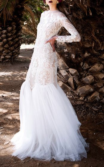 Bridal is what Christos Costarellos is known for. And with good reason: breathtaking gowns in varied silhouettes with a Grecian-inspired bohemia make up his stunning collection this season.