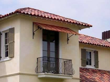 Spanish Revival · Terracotta Tiles (flat?) On Substrate, Then Mounted With  Wrought Iron Awning Supports