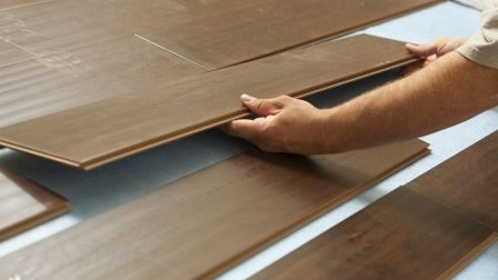 Want The Look Of A Hardwood Floor Without The Expense Home Gym Flooring Flooring Laminate Flooring