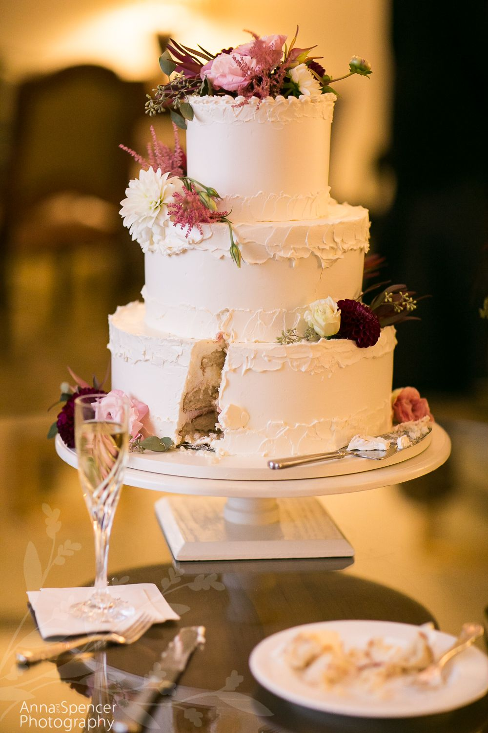 Wedding Cake With Shades Of Maroon Flowers Frosted Pumpkin Bakery