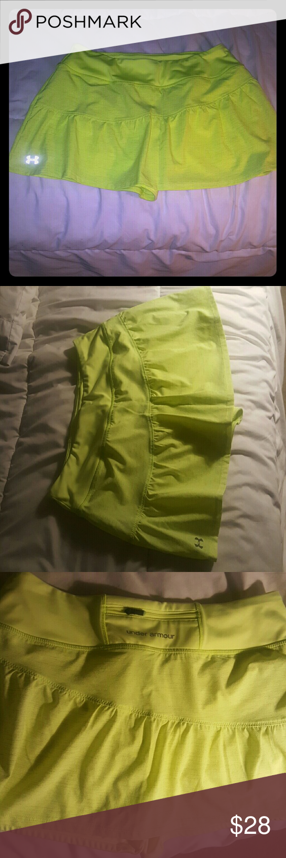 Under armour skirt/shorts g.c med Good condition lime/green color Under Armour Skirts Mini