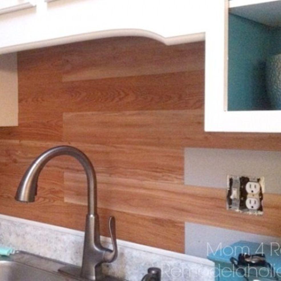 Plank A Kitchen Backsplash Using Peel And Stick Flooring With