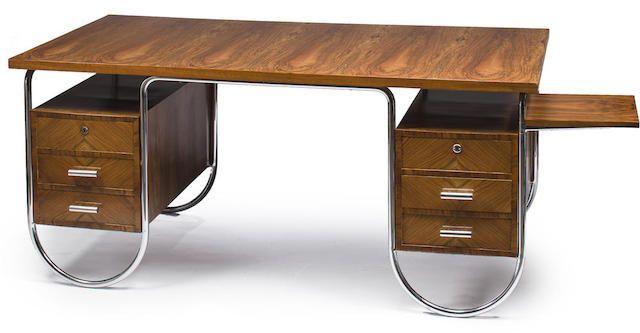 A Marcel Breuer walnut and tubular chrome double pedestal desk  produced by Columbus Tubing Company of Milan, Italy, circa 1933