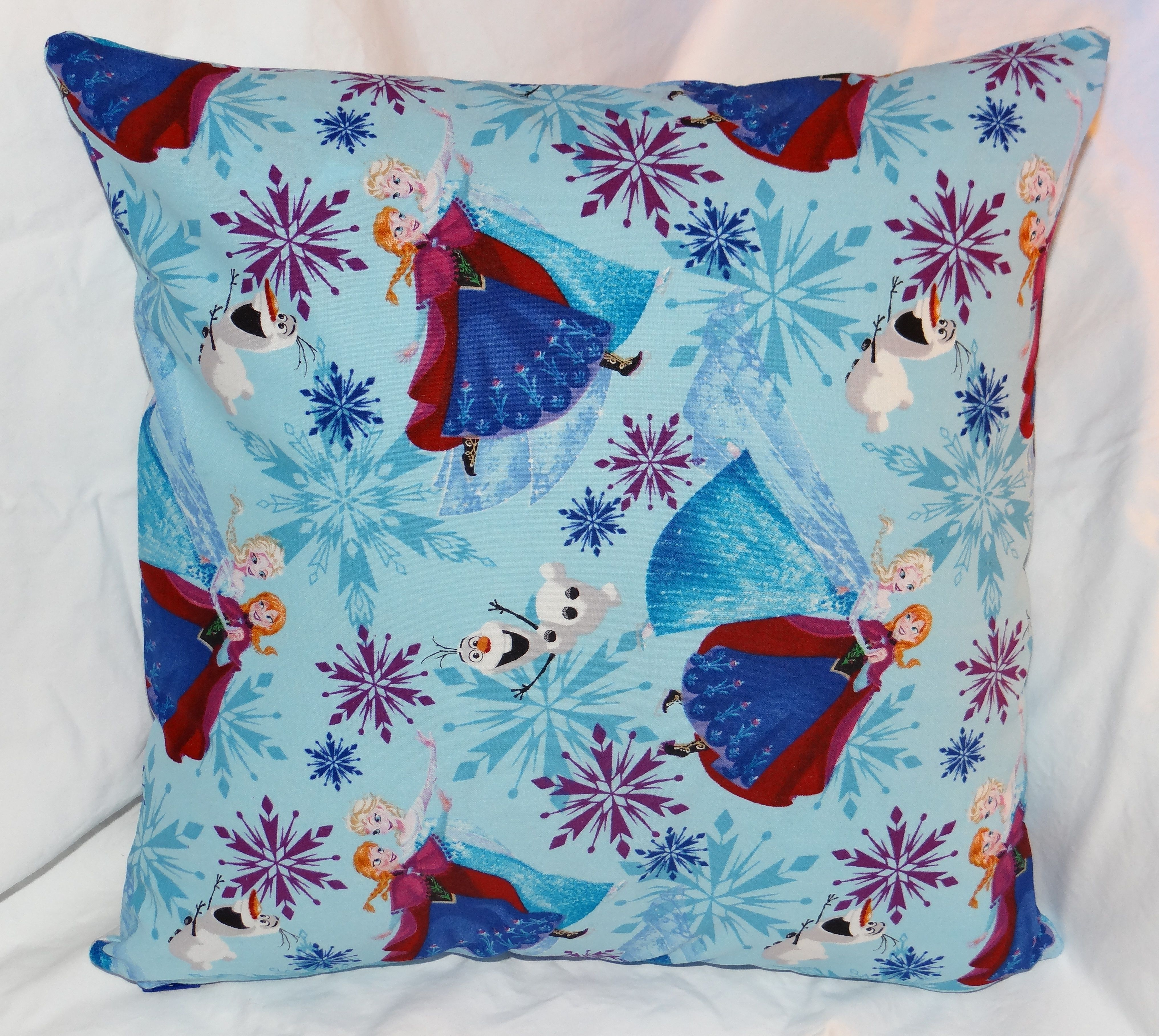 """The first style of Frozen character pillows.  It is a 14"""" pillow with a zipper in the bottom for easy washing."""