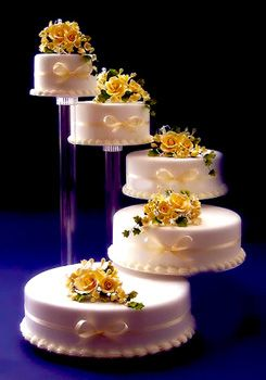 5 Tier Spiral Type Wedding Cake Structure With Rose Flowers