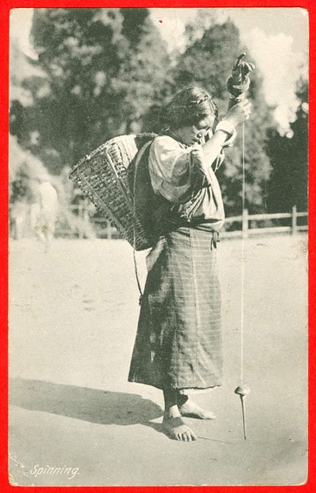 Darjeeling, India, woman spinning with high whorl spindle (probably wool). Note: At this site threre are pictures of spindles and spinners from all over the world.