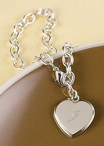 """Linked bracelet features a heart pendant personalized with a single initial, in your choice of font. This silver-plated bracelet is 9"""" long.  View Font Selections"""