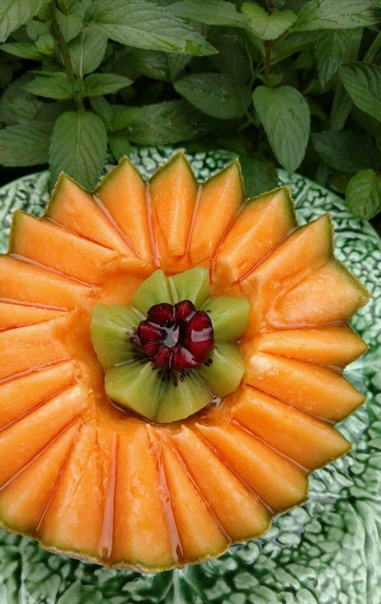 Cantaloupe, kiwi and cherry salad, add a splash of honey. A buen tiempo! Enjoy!