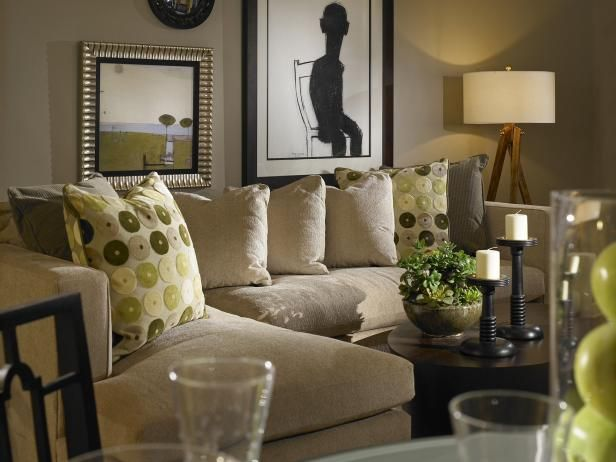 HGTV Showcases A Neutral Living Room With Gray Walls And Green Accents