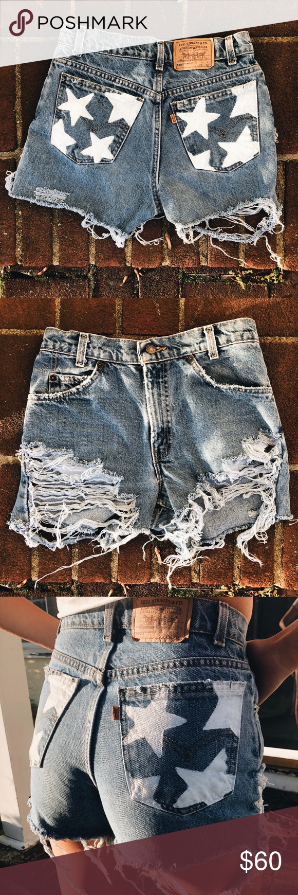 Hand painted white star pocket Levi shorts Denim shorts made and ripped from Levi jeans. I ripped and painted them myself. White stars on back pockets. Very distressed. Men's sizing says W 29 L 32. Girl in pic wearing shorts wears sizes 0/2 in shorts. Perfect for Fourth of July, USA or American flag parties! Levi's Shorts Jean Shorts