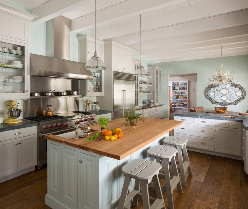 pale aqua walls, white cabinets, mismatched doors and counters