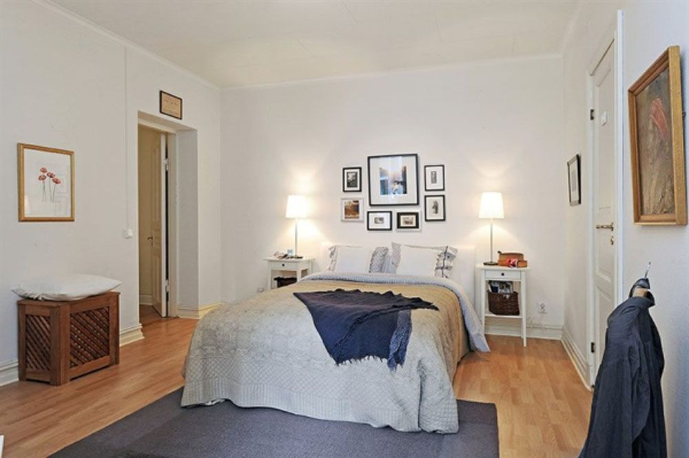 Apartments. Small Apartment Bedroom Design Use Brown Laminate Flooring And Also Grey Carpet