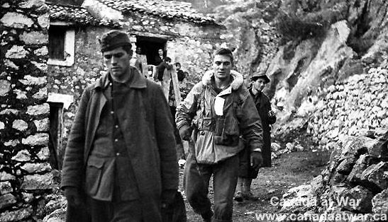 Italy (Misc.) - A January 1944 picture showing Private N.L. Shauer (right) of the Devil's Brigade bringing in a German prisoner near Vanafro, italy.