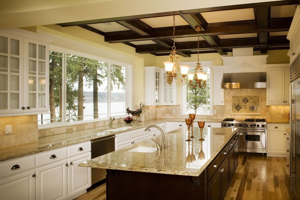 Traditional Kitchen with Simple granite counters, Coffered