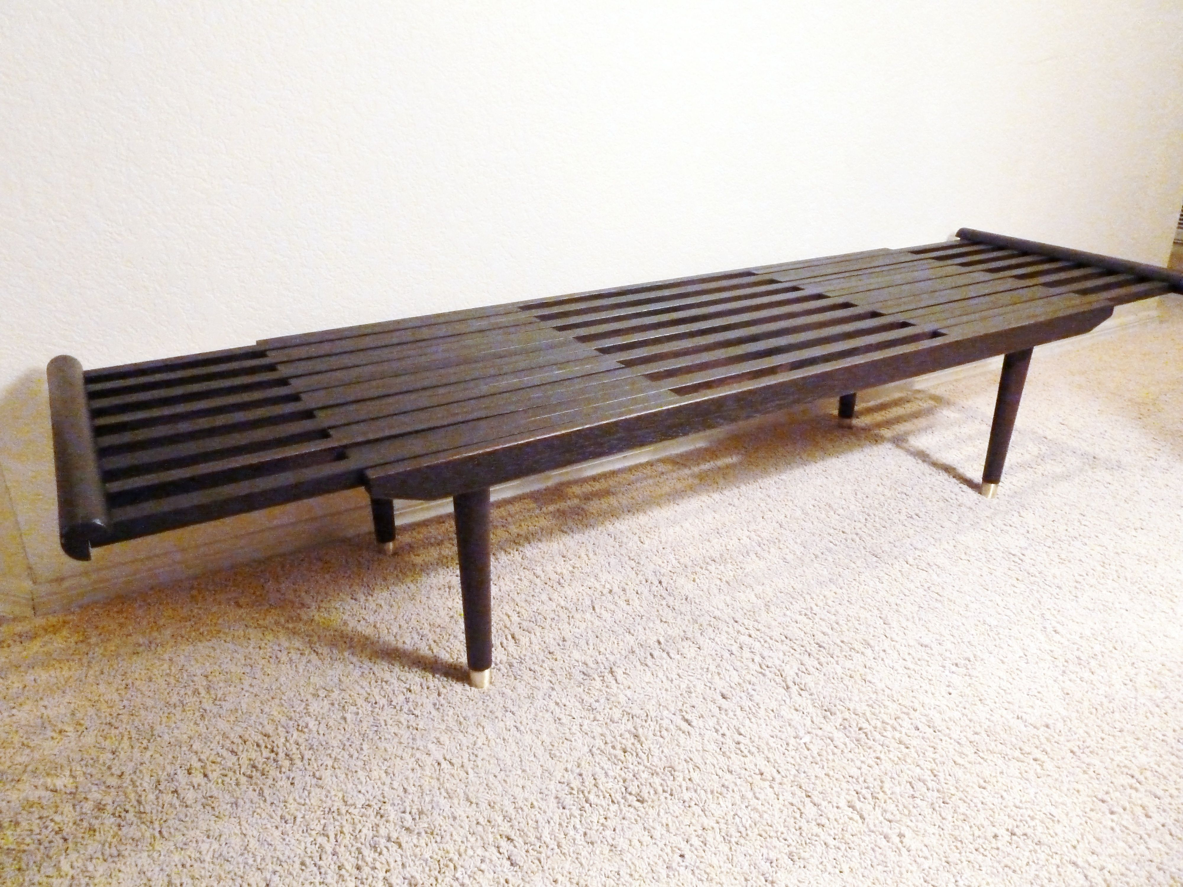 Classic expandable slat bench coffee table with an ebony finish