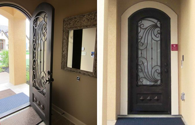 Wrought iron front entry door from Door Clearance Center installed ...