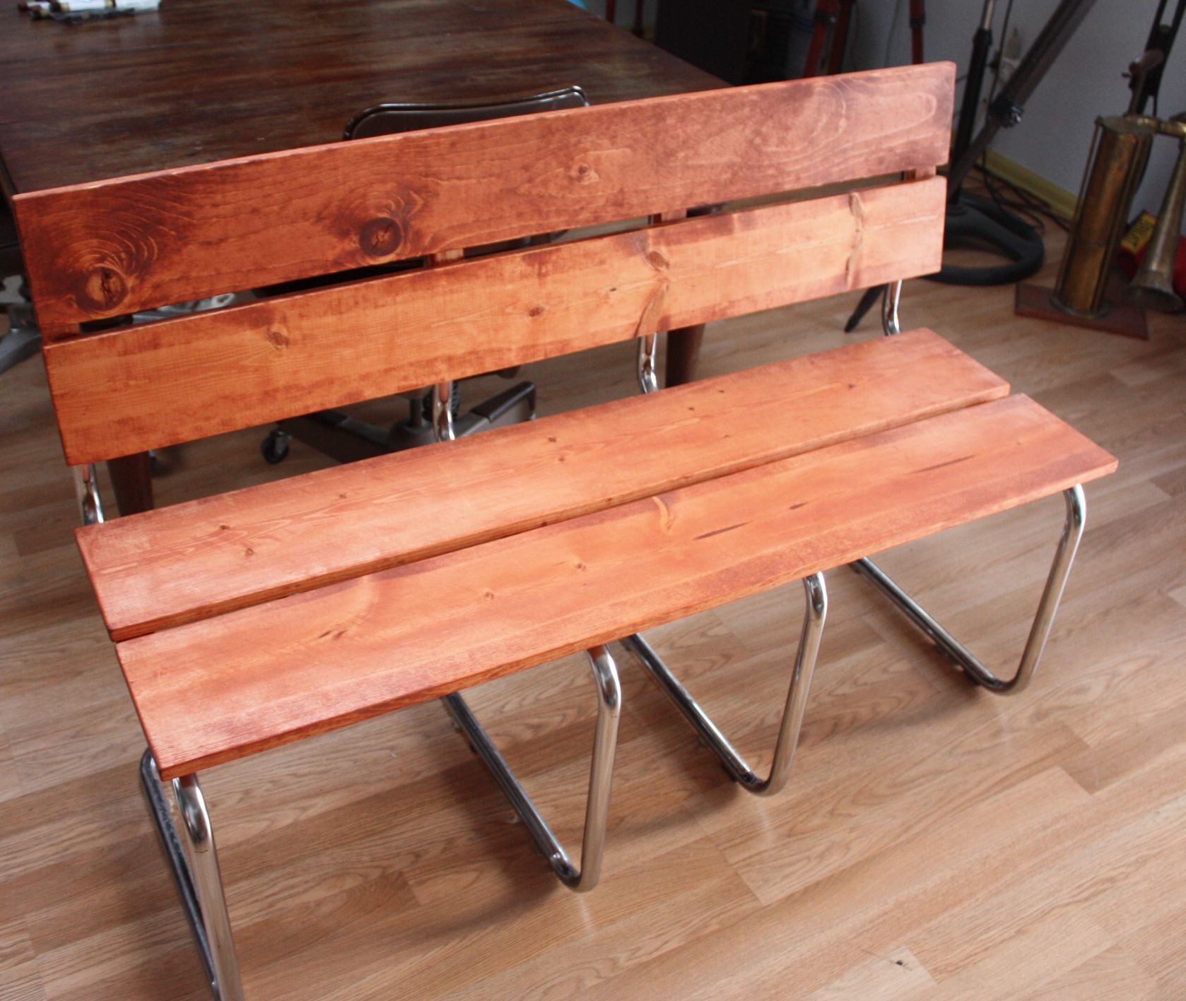 Upcycle design from two old metal chairs with wicker backs.  Used the metal to create this cool bench that we saw on Pintrest.